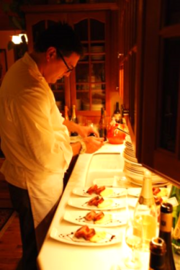Chef Carlos is putting the finishing touches on his culinary creations